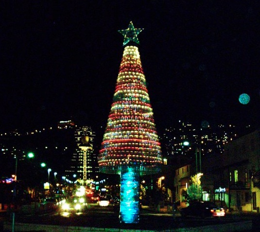 In the absence of all the trees burnt during the recent Carmel fire in Israel, a Christmas tree made from 5,480 plastic bottles stands tall in Haifa.